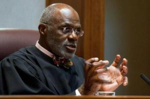 Minnesota Supreme Court Justice Alan Page, a former Vikings hall of famer, has written a children's book about his odd pinky, a finger that's permanently bent outward at a 90-degree angle. The book, which will be released next week, is called